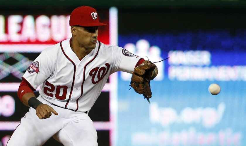 Washington Nationals shortstop Ian Desmond fields a ball hit by Toronto Blue Jays' Josh Donaldson during the fifth inning of the second baseball game of a doubleheader at Nationals Park, Tuesday, June 2, 2015, in Washington. Donaldson was out at first base on the play. (AP Photo/Alex Brandon)