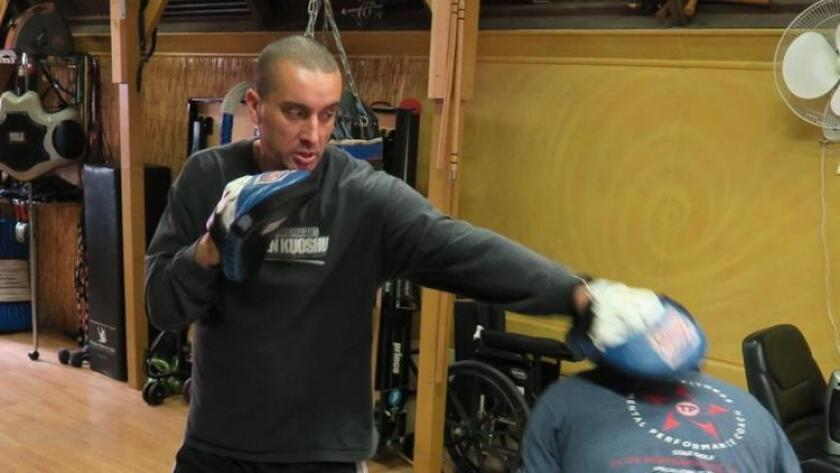 Greg Fraser works out at his martial arts studio in Pacific Beach. (Ken Lewis)