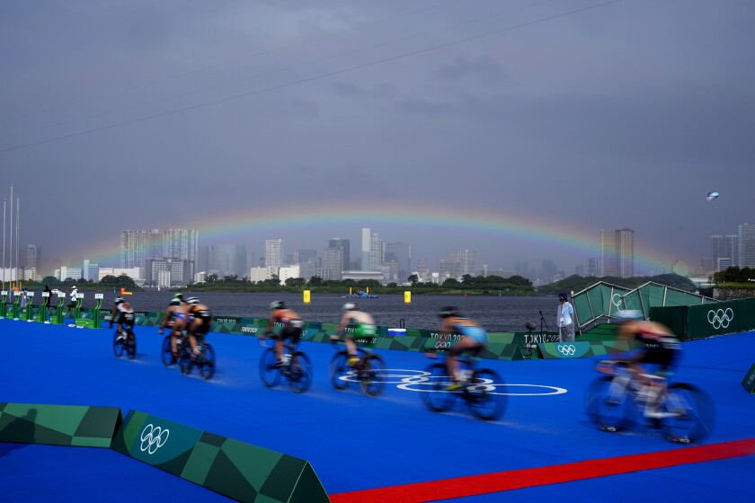 A rainbow appears as athletes compete in the bike leg of the women's individual triathlon competition at the 2020 Summer Olympics, Tuesday, July 27, 2021, in Tokyo, Japan. (AP Photo/David Goldman)