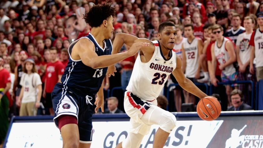 Zach Norvell Jr. (23) of the Gonzaga Bulldogs drives against Dameane Douglas (13) of the Loyola Marymount Lions in the second half at McCarthey Athletic Center on January 17, 2019 in Spokane, Washington.