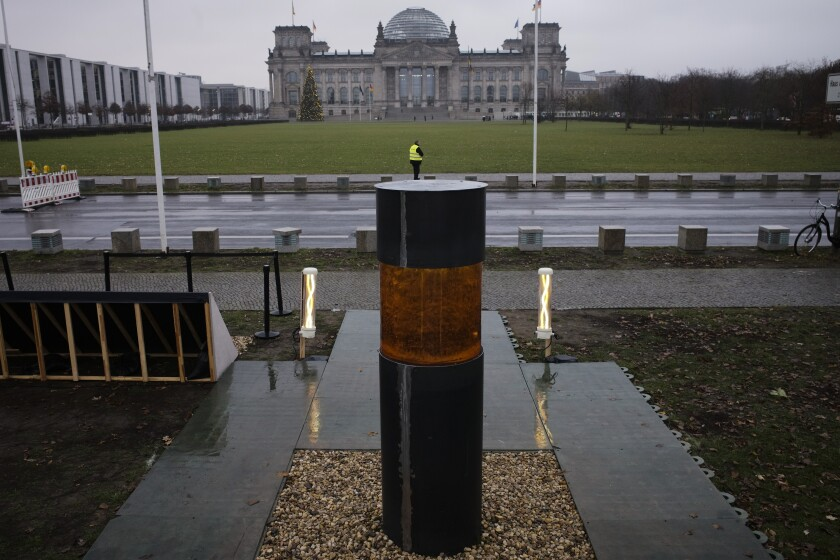 "This Monday, Dec. 2, 2019 photo shows an oversized urn placed by the artist group 'Center for Political Beauty"" in front of German parliament building, the Reichstag, in Berlin, Germany. The artist group says the urn contains human remains of Holocaust victims. (Photo/Markus Schreiber)"