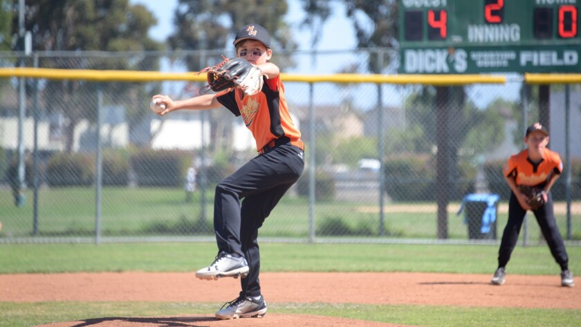 Carson Hunnicutt throws a pitch for the Huntington Beach West Little League (Orioles) in a District