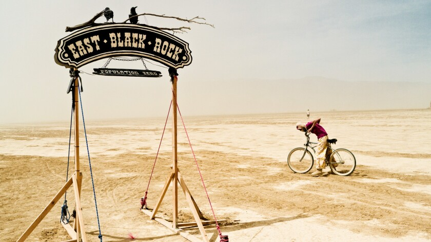 Conservative pundit and anti-tax activist Grover Norquist reported on Twitter that he is going to Burning Man this summer. Seen here: an entrance to Black Rock City, Nevada, otherwise known as the playa.