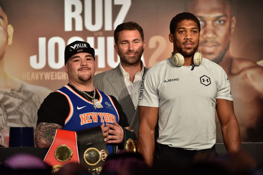 Andy Ruiz Jr., left, Eddie Hearn, center, and Anthony Joshua are pictured during their press conference in Diriyah in the Saudi capital Riyadh, on Wednesday,