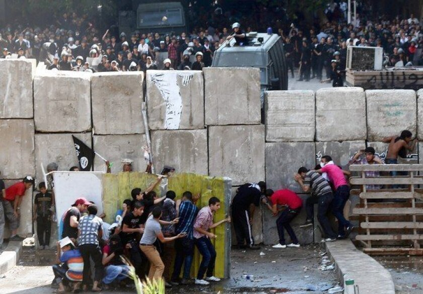 The raucous protests outside the U.S. Embassy in Cairo strained relations between the U.S. and Egypt's new rulers.