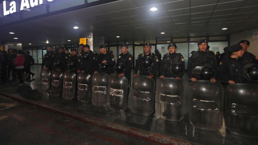 Anti-riot police stand guard at the La Aurora International Airport in Guatemala City, Guatemala on Jan. 6.