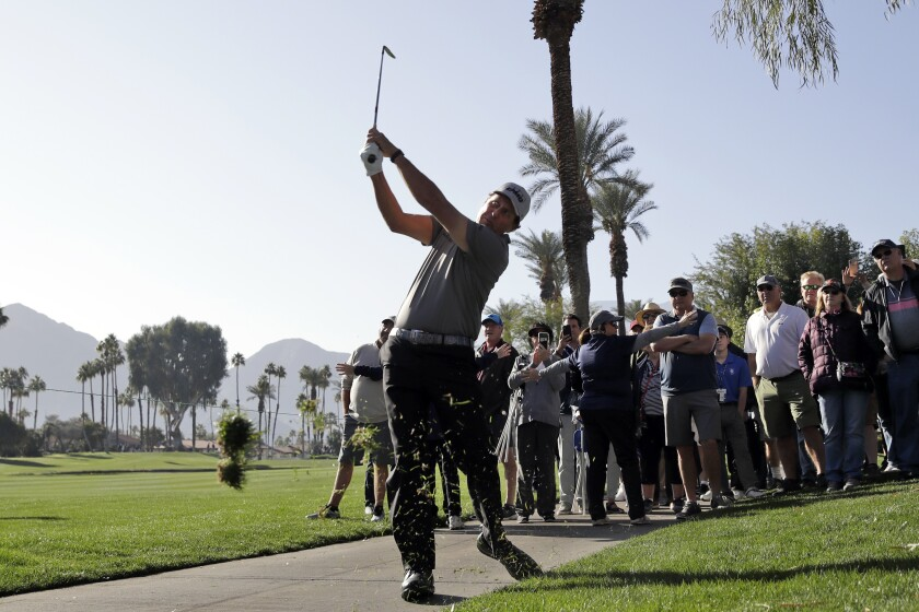 Phil Mickelson hits from the rough on the fourth hole during the first round of the American Express golf tournament at La Quinta Country Club on Jan. 16, 2020.