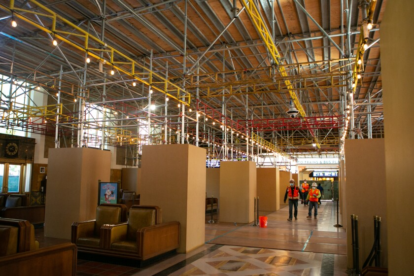 Scaffolding obscures work areas in the Union Station waiting room.