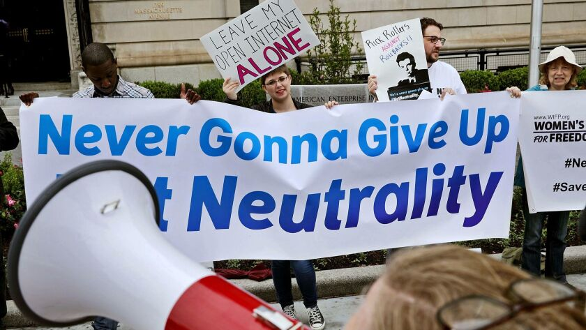 Proponents of net neutrality protest against Federal Communication Commission Chairman Ajit Pai outside the American Enterprise Institute before his arrival May 5 in Washington.