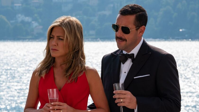 "Jennifer Aniston and Adam Sandler in the movie ""Murder Mystery."""