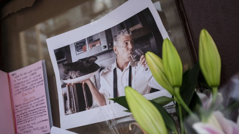 Notes and photographs are left in memory of Anthony Bourdain at the closed location of New York's Brasserie Les Halles, where he was the executive chef.