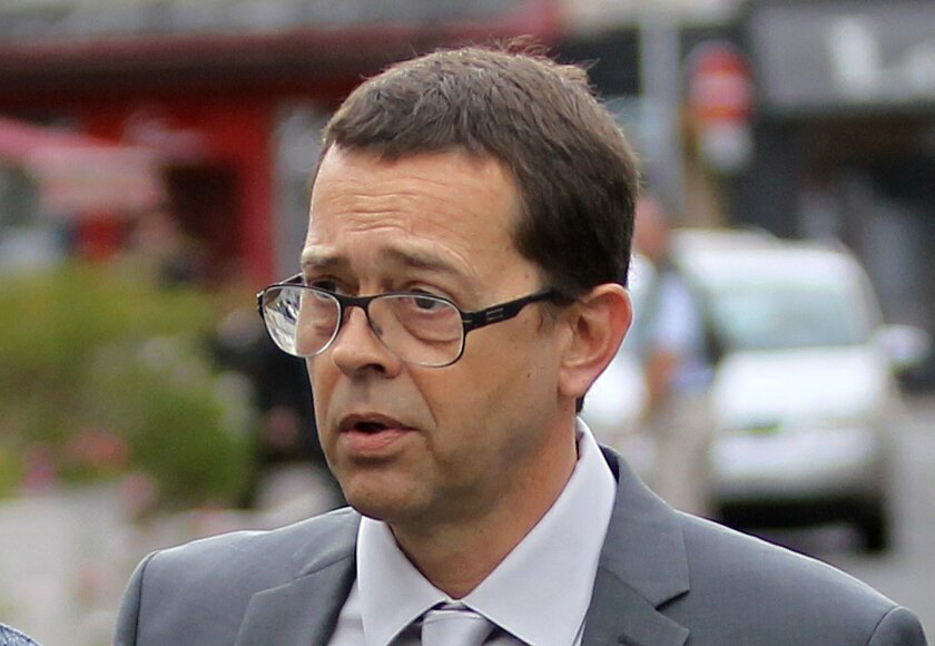 Former Bayonne's hospital doctor Nicolas Bonnemaison arrives at the courthouse of Pau, southwestern France, for the first day of his trial, Wednesday, June 11, 2014. Bonnemaison is accused having poisoned 7 terminally ill patients in 2010 and 2011. The trial comes amid debate in France over whether to legalize euthanasia or other means of ending medical care for terminally ill patients. (AP Photo/Bob Edme)