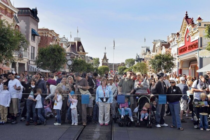 Visitors on Main Street U.S.A. await Disneyland's opening after its sprucing up by the night crew, upholding founder Walt Disney's vision of an immaculate land, free of the litter and grime of the outside world.