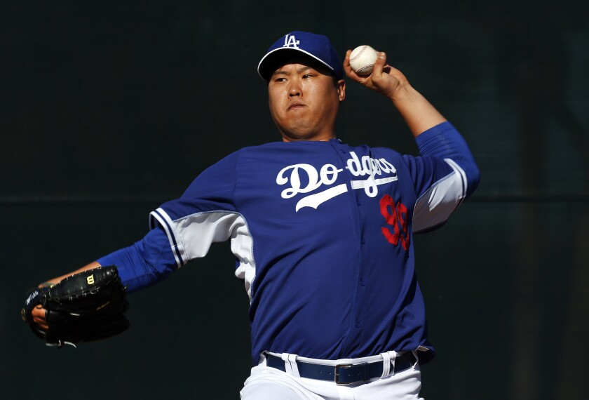 Dodgers left-hander Hyun-Jin Ryu throws a pitch during a spring training practice on Feb. 9. Ryu has not appeared in a single game this season because of his left shoulder injury.