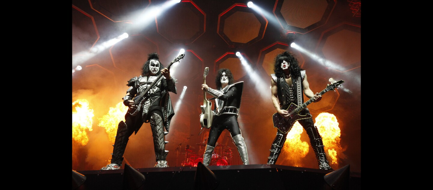 "Kiss band members, from left, Gene Simmons, Tommy Thayer, and Paul Stanley perform during the ""End of the Road World Tour"" farewell concert at the Viejas Arena."