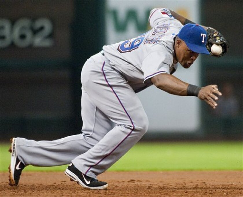Texas Rangers third baseman Adrian Beltre fields a ball hit by Houston Astros' Hunter Pence during the third inning of a baseball game Thursday, June 30, 2011, in Houston. Beltre threw out Pence on the play. (AP Photo/Dave Einsel)