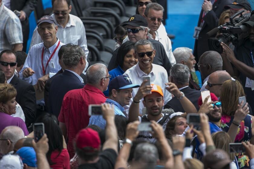 President Barack Obama mixes with the baseball fans at the Cuba-Tampa Bay Rays matchup.