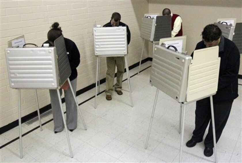 Voters fill the booths at the first Baptist Church of Dent in Dent, Ohio on Tuesday Nov. 2, 2010. (AP Photo/The Cincinnati Enquirer, Ernest Coleman) MANDATORY CREDIT