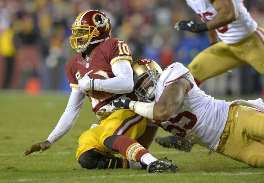San Francisco outside linebacker Ahmad Brooks sacks Washington quarterback Robert Griffin III at FedEx Field on Monday night.