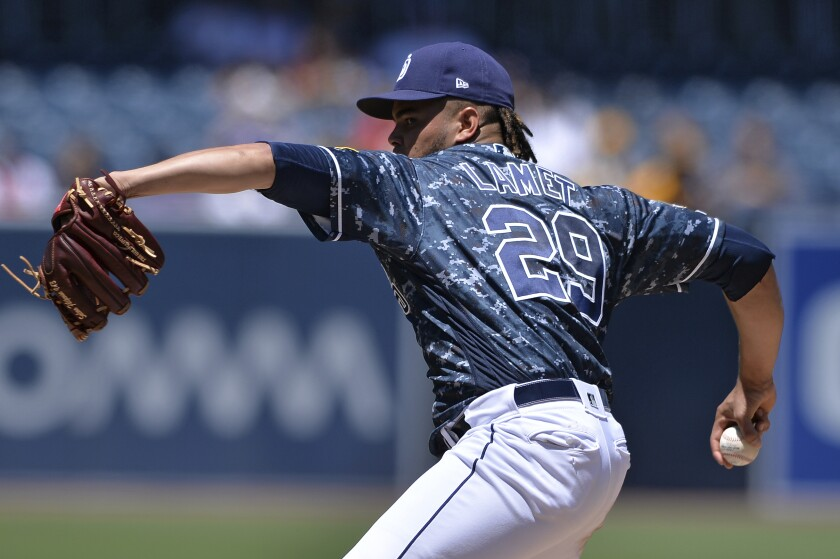 Padres starting pitcher Dinelson Lamet works against a Colorado Rockies batter during the first inning of the baseball game Sunday, Aug. 11, 2019, in San Diego.