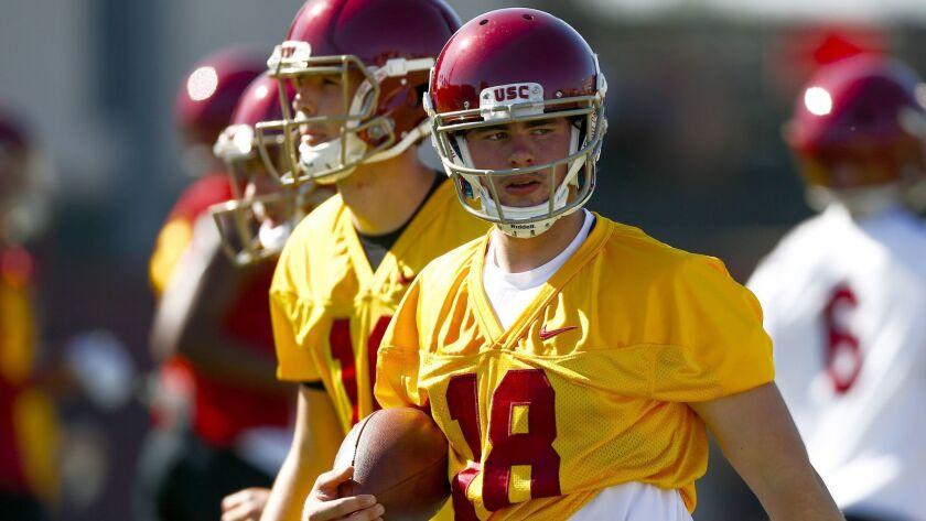 LOS ANGELES, CALIF. - AUGUST 03: USC Trojans quarterback JT Daniels (18) carries a ball as the USC T