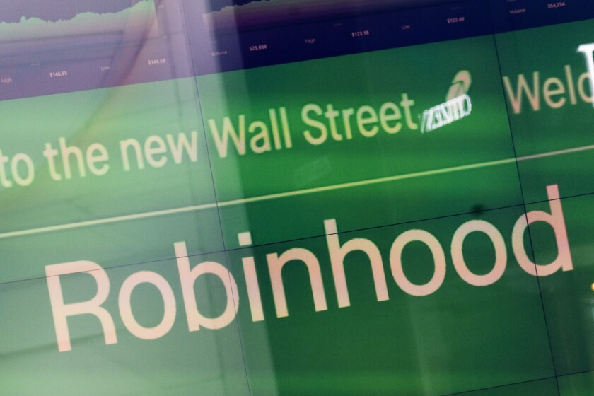 FILE - An electronic screen at Nasdaq displays Robinhood in New York's Times Square following the company's IPO, Thursday, July 29, 2021. Robinhood announced Tuesday, Oct. 5, 2021 that it's offering 24/7 phone support for all its customers to cover almost every issue. It follows up on an announcement by Coinbase, which said last month it would launch 24/7 phone service by the end of the year for many customers. (AP Photo/Mark Lennihan, File)