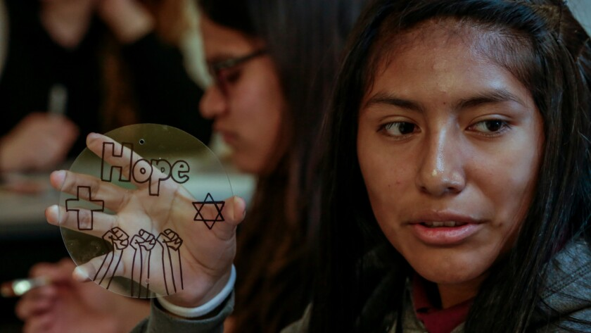 Sarai España works on her piece of the collaborative art project, made during the Museum of the Holocaust's survivor outreach program.