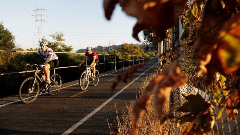 Cyclists enjoy a ride along the Los Angeles River.
