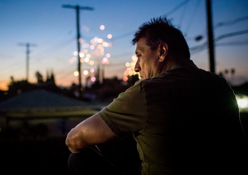 ARLETA, CA - July 4, 2018 A week after his release, Jose Garcia watches fireworks from his rooftop
