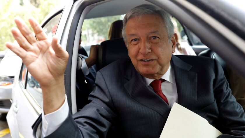 Lopez Obrador, presidential pre-candidate of (MORENA), waves as he leaves an event during which he unveiled his anti-corruption plan in Mexico City