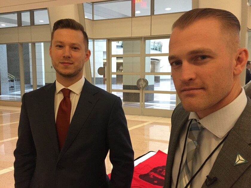 Nathan Damigo, right, at a National Policy Institute conference in Washington.