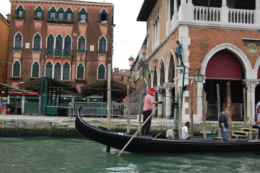 Gondoliers wearing masks sanitized their boats on May 18, 2020, but were not taking customers yet.