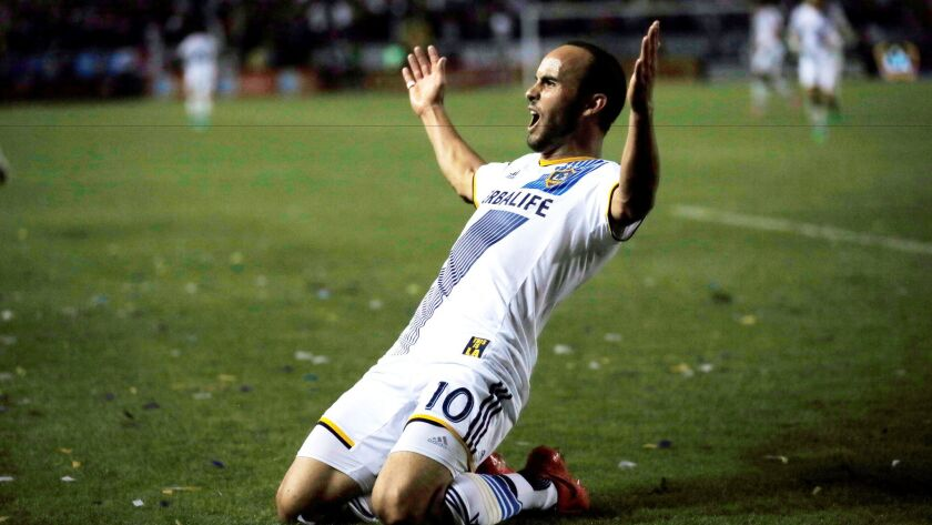 Los Angeles Galaxy's Landon Donovan celebrates scoring a goal against Real Salt Lake during the second half of an MLS soccer Western Conference playoff series game, in Carson, Calif., Sunday, Nov. 9, 2014. (AP Photo/Danny Moloshok) ** Usable by LA, DC, CGT and CCT Only **