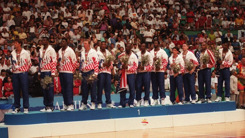 """Members of the USA basketball """"Dream Team"""" pose with their gold medals after defeating Croatia, 117–85 to claim the olympic medal in Barcelona, Spain on Aug. 8, 1992."""