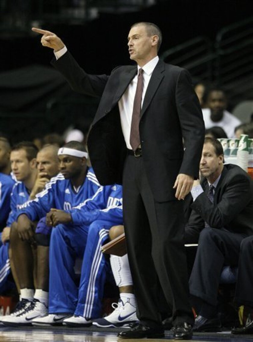 Dallas Mavericks head coach Rick Carlisle instructs his team in the first half of a NBA preseason basketball game against the Washington Wizards Tuesday, Oct. 5, 2010 in Dallas. The Wizards won 97-94. (AP Photo/Tony Gutierrez)