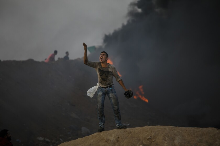 DEIR AL-BALA, GAZA -- TUESDAY, MAY 15, 2018: A Palestinian man taunts his fellow protester about not