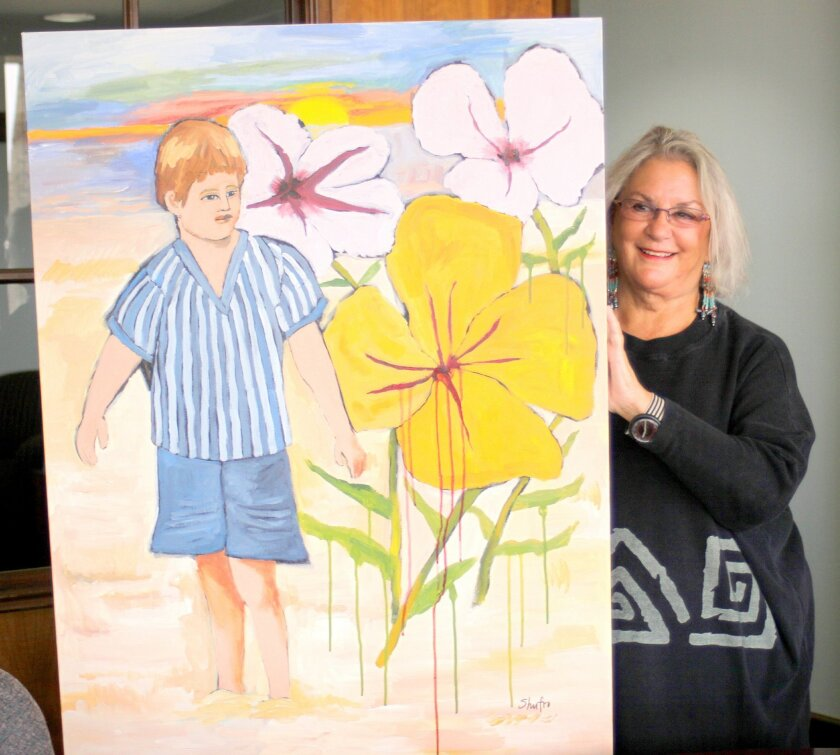 Judy Shufro with one of her paintings