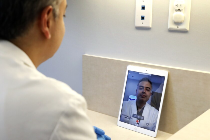 Virus Outbreak Health Care Finances