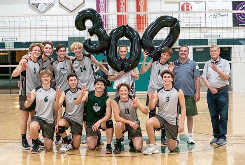 Poway High varsity boys volleyball team celebrating their head coach Charlie Jackson achieving 300 career wins on April 29.