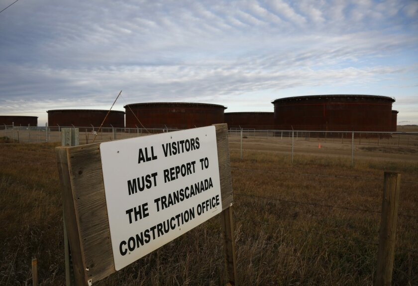 A sign is posted in front of TransCanada's Keystone pipeline facilities are in Hardisty, Alberta, Canada, on Friday, Nov. 6, 2015.  Following the Obama administration's rejection of the Keystone XL pipeline, the oil industry faces the tricky task of making sure the crude oil targeted for the pipeli