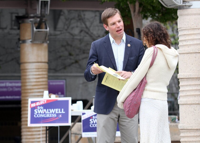 Rep. Eric Swalwell (D-Dublin) passes out fliers to commuters in Castro Valley.