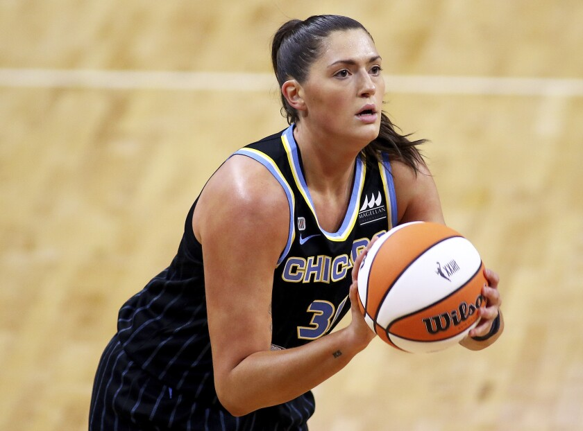 FILE - In this May 15, 2021, file photo, Chicago Sky center Stefanie Dolson controls the ball during a WNBA basketball game against the Connecticut Mystics in Washington. Sky star Dolson is checking in periodically from the Olympics. She is part of the U.S. 3x3 team that will take part in the inaugural competition in that event at the Tokyo Games. (AP Photo/Daniel Kucin Jr.)