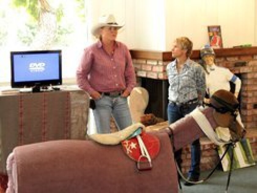 Thoroughbred jockey Julie Krone (right) spoke to guests at the RSF Riding Club