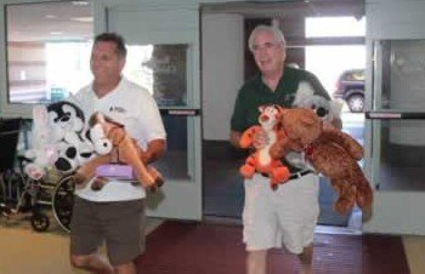 La Jollans Bill Bennett (left) and Jim Broutzos delivered toys to Rady Children's Hospital on Sunday, June 24. Photos by Pat Sherman