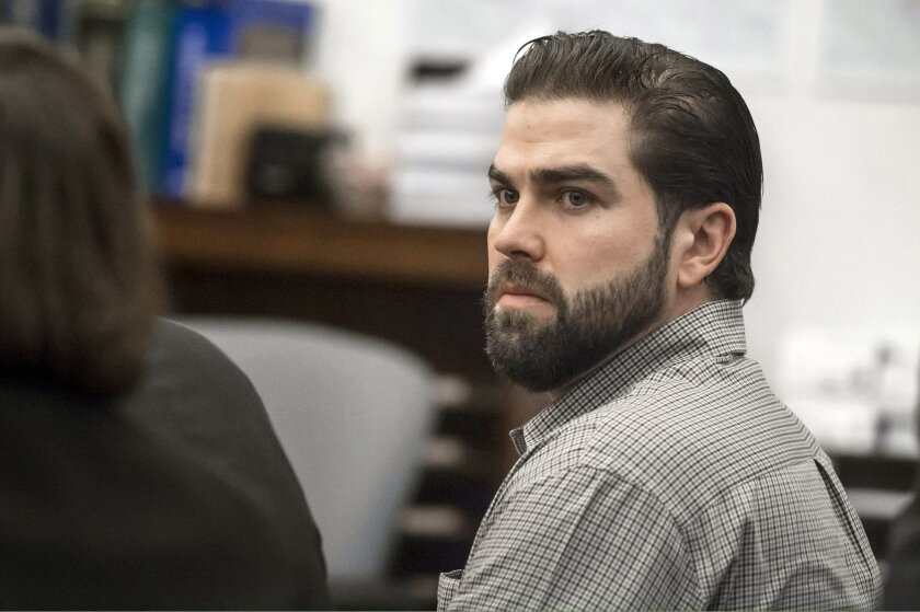 Daniel Wozniak listens to closing arguments during the penalty phase of his trial in Santa Ana on Monday.