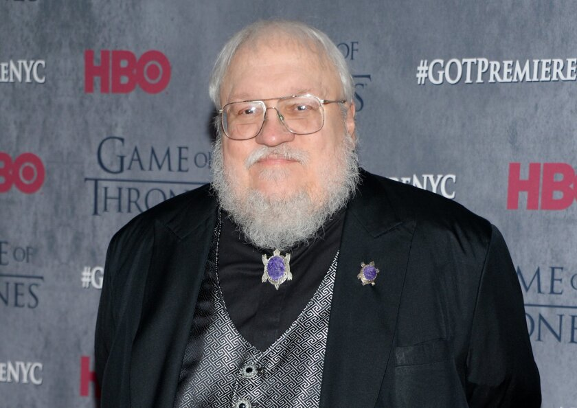 """FILE - In this March 18, 2014 file photo, author and co-executive producer George R. R. Martin attends HBO's """"Game of Thrones"""" fourth season premiere in New York.The """"Game of Thrones"""" author released a chapter Thursday, April 2, 2015, from his very long-awaited sixth volume of the """"Song of Fire and Ice"""" fantasy series, """"The Winds of Winter."""" The chapter appears on Martin's web site and is told from the perspective of Sansa Stark, living under the name Alayne Stone. (Photo by Evan Agostini/Invision/AP, File)"""