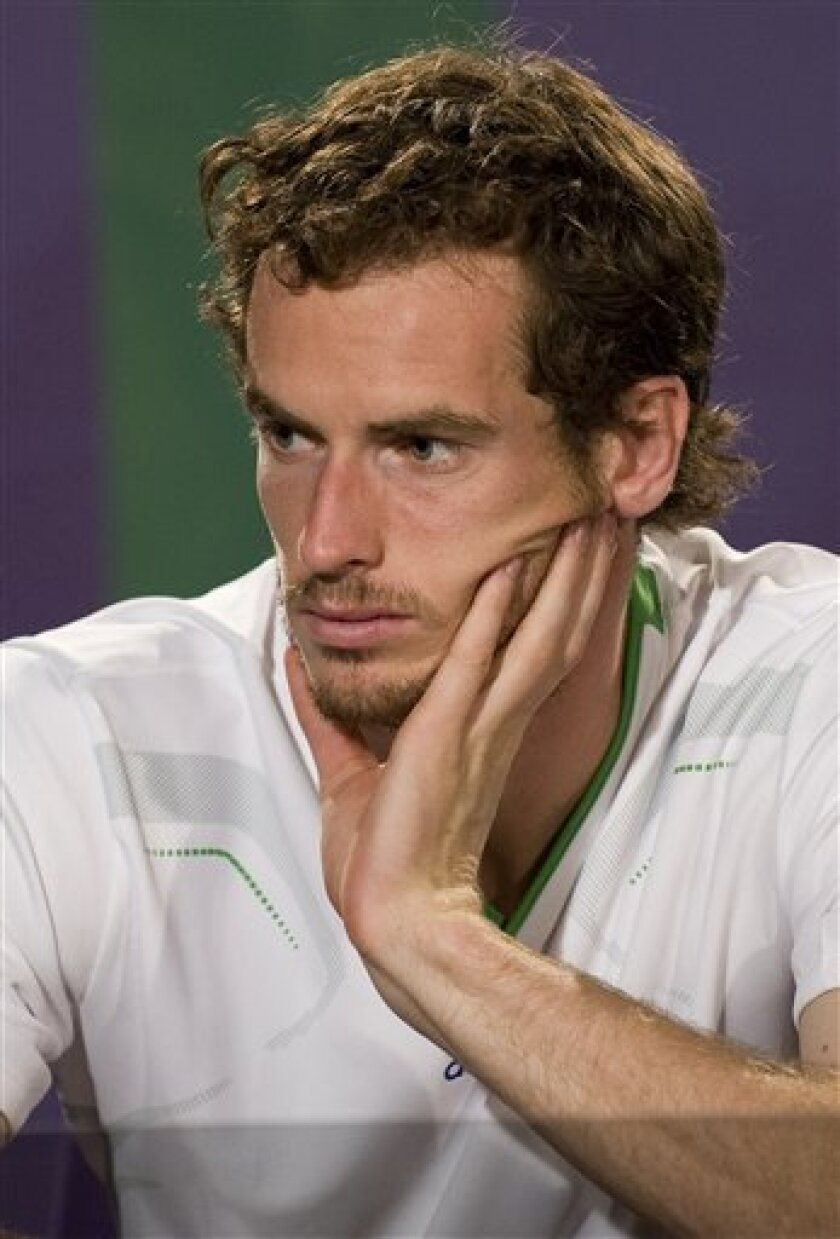 Britain's Andy Murray answers questions at a press conference following his loss to Spain's Rafael Nadal in their men's semifinal match at the All England Lawn Tennis Championships at Wimbledon Friday, July 1, 2011. (AP Photo/AELTC,Nigel Tingle,Pool)