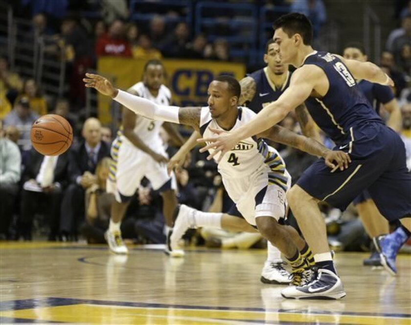 Marquette's Todd Mayo (4) chases down a loose ball ahead of Pittsburgh's Steven Adams, right, during the second half of an NCAA college basketball game Saturday, Feb. 16, 2013, in Milwaukee. (AP Photo/Jeffrey Phelps)
