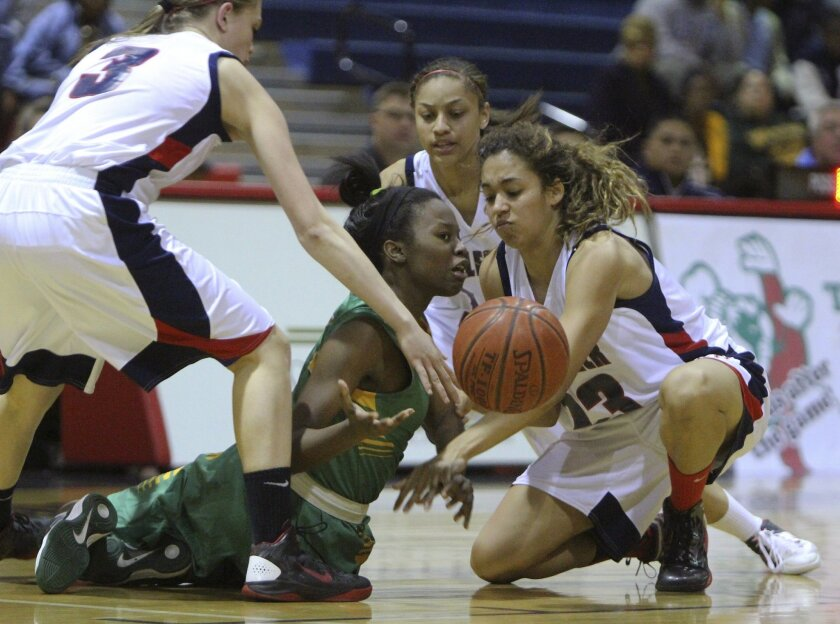 Great Oak's Abby Welch #3, Adrianna Carrillo #12, and Mikayla Williams #23, try and get the ball from Long Beach Poly's Tania Lamb, as she goes down during a CIF SS playoff game Wednesday night.