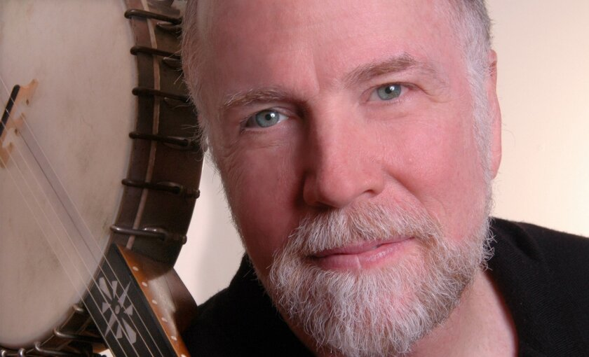 'When I get out of bed every morning, I can't wait to do my job,' says singer John McCutcheon.